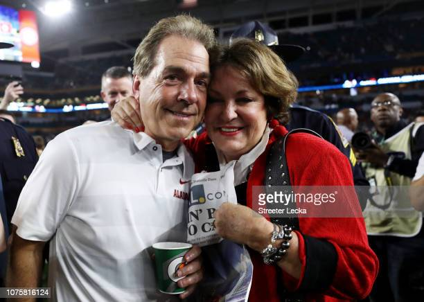 Head coach Nick Saban of the Alabama Crimson Tide celebrates with his wife after the win over the Oklahoma Sooners during the College Football...