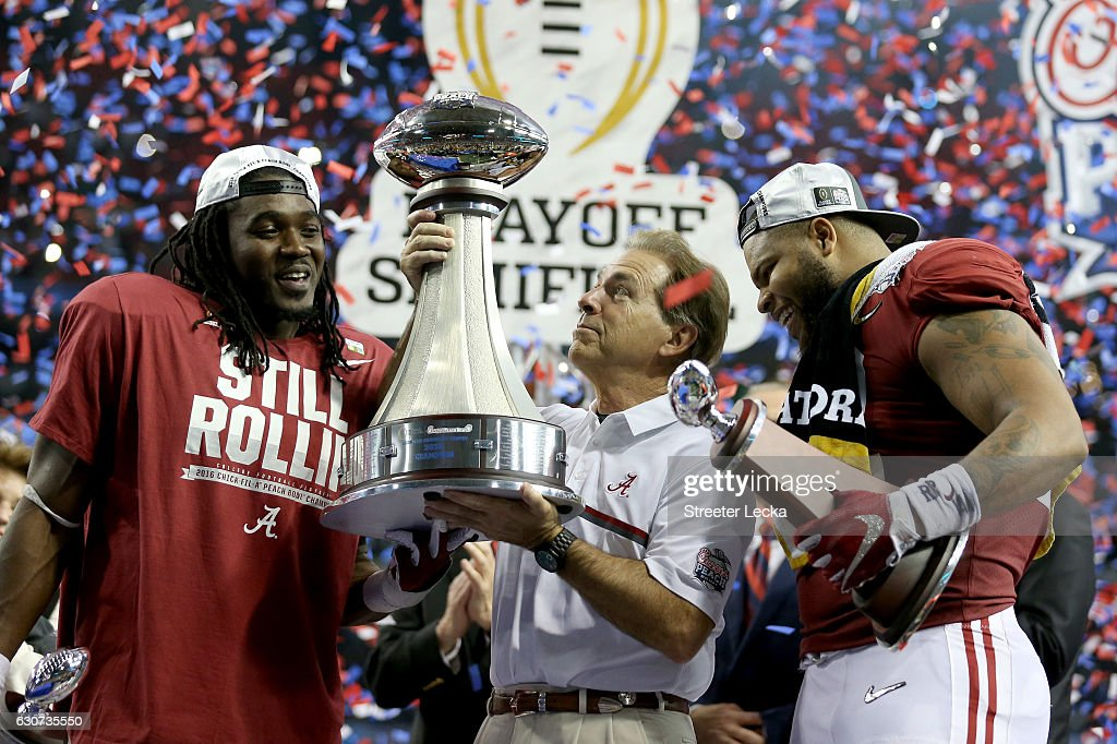 Head Coach Nick Saban of the Alabama Crimson Tide celebrates with offensive player of the game Bo Scarbrough #9 of the Alabama Crimson Tide and defensive play of the game Ryan Anderson #22 of the Alabama Crimson Tide after winning 24 to 7 against the Washington Huskies during the 2016 Chick-fil-A Peach Bowl at the Georgia Dome on December 31, 2016 in Atlanta, Georgia.