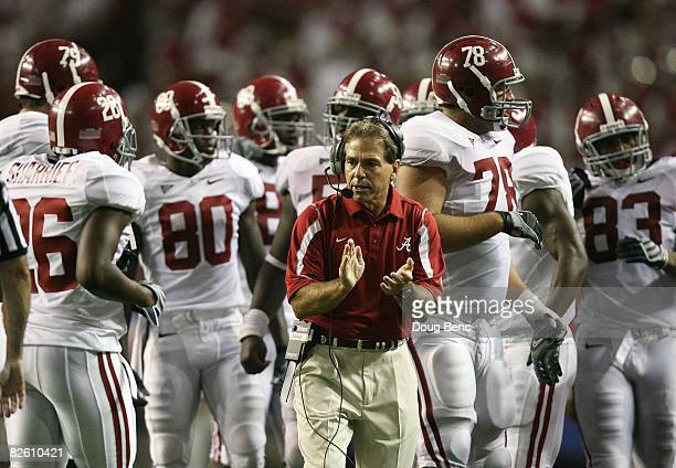 Head coach Nick Saban of the Alabama Crimson Tide cheers his team on after making a fourth down stop late in the game against the Clemson Tigers at...