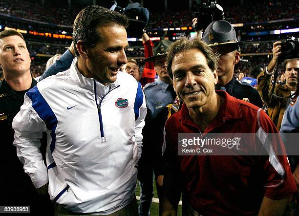 Head coach Nick Saban of the Alabama Crimson Tide congratulates head coach Urban Meyer of the Florida Gators after the Gators 3120 win in the SEC...