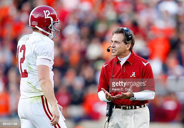 Head coach Nick Saban of the Alabama Crimson Tide converses with quarterback Greg McElroy during the game against the Auburn Tigers at JordanHare...
