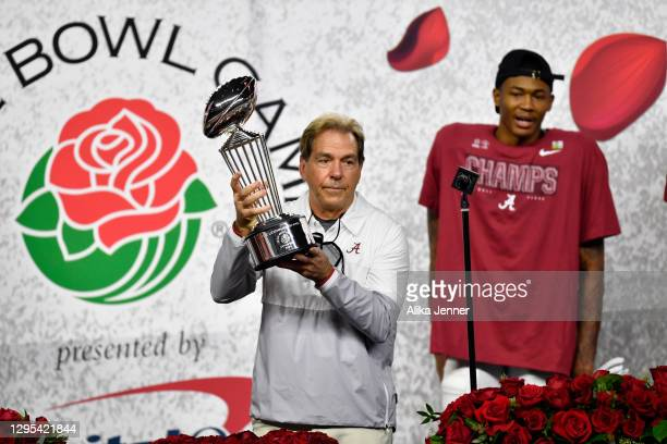 Head coach Nick Saban of the Alabama Crimson Tide holds up the Leishman Trophy after the College Football Playoff Semifinal at the Rose Bowl football...