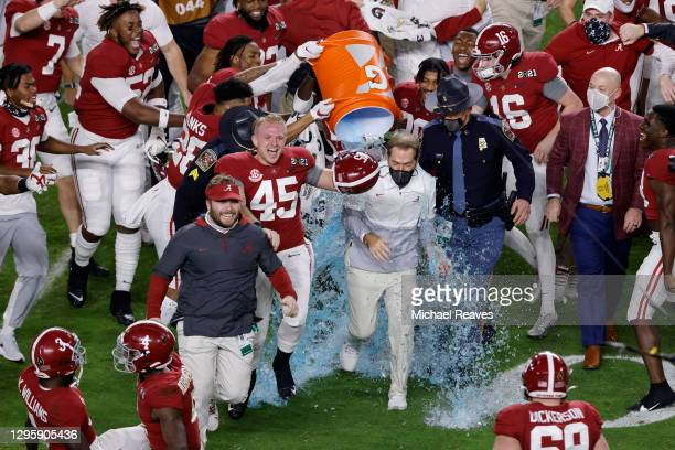 Head coach Nick Saban of the Alabama Crimson Tide is dunked with gatorade following the College Football Playoff National Championship game in-which...
