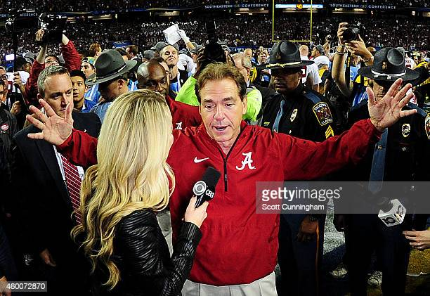 Head coach Nick Saban of the Alabama Crimson Tide is interviewed after their 42 to 13 win over the Missouri Tigers in the SEC Championship game at...