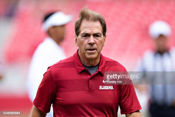 Head Coach Nick Saban of the Alabama Crimson Tide jogs off the field before a game against the Arkansas Razorbacks at Razorback Stadium on October 6...