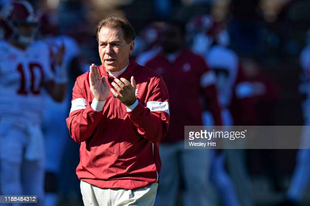 Head Coach Nick Saban of the Alabama Crimson Tide on the field watching his team warm up before a game against the Mississippi State Bulldogs at...