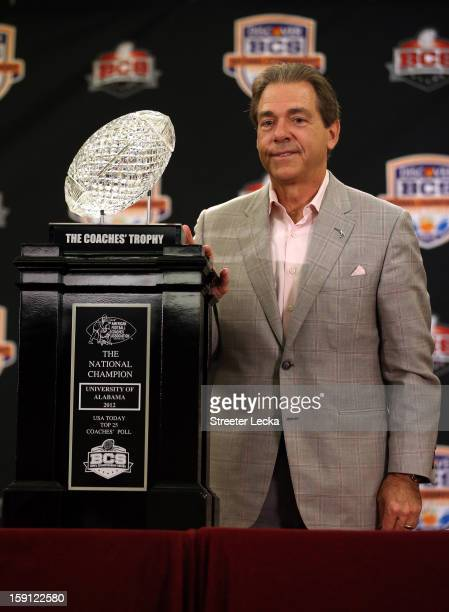 Head coach Nick Saban of the Alabama Crimson Tide poses with the National Championship trophy during the Discover BCS National Championship Press...