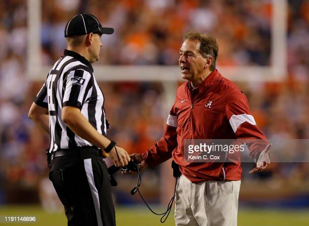 Head coach Nick Saban of the Alabama Crimson Tide reacts to head linesman Thomas Eaton during the game against the Auburn Tigers at Jordan Hare...