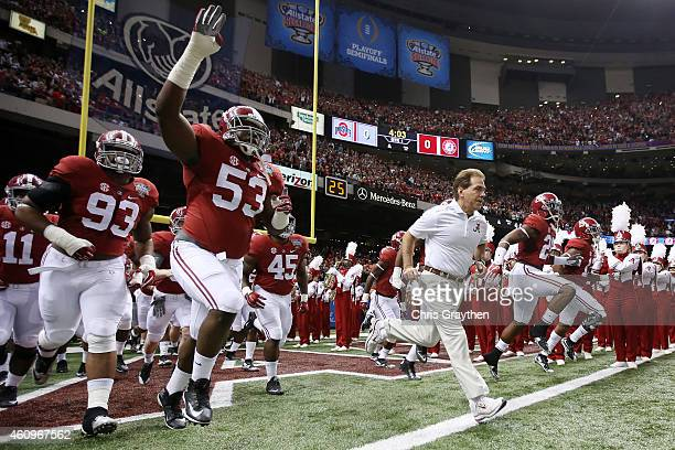 Head coach Nick Saban of the Alabama Crimson Tide runs on the field before playing the Ohio State Buckeyes during the All State Sugar Bowl at the...
