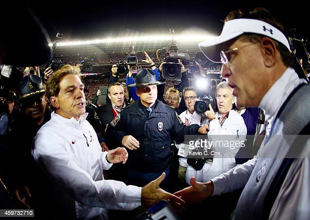 Head coach Nick Saban of the Alabama Crimson Tide shakes hand with head coach Gus Malzahn of the Auburn Tigers after the Iron Bowl at Bryant-Denny...