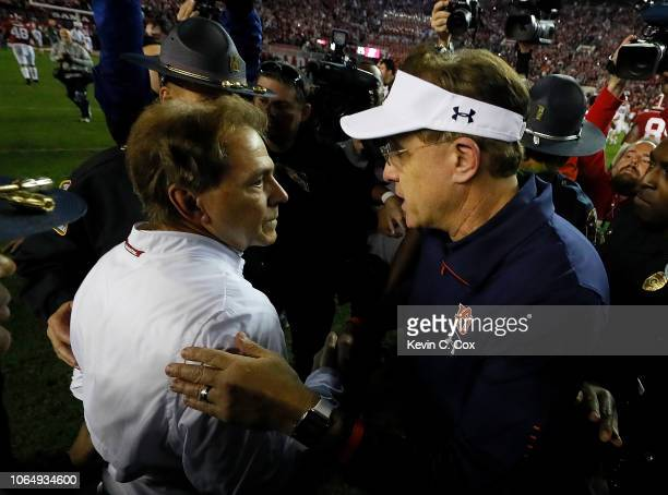Head coach Nick Saban of the Alabama Crimson Tide shakes hands with head coach Gus Malzahn of the Auburn Tigers after their 5221 win at BryantDenny...