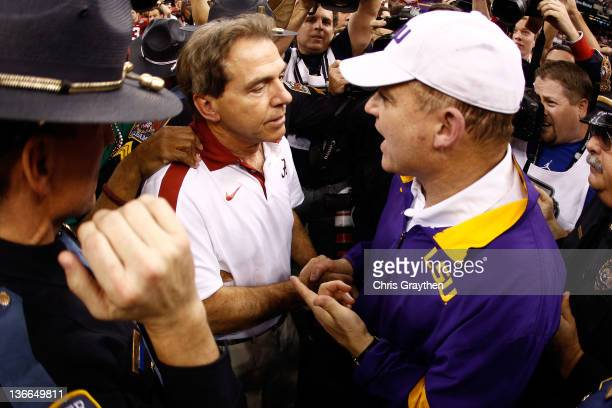 Head coach Nick Saban of the Alabama Crimson Tide shakes hands with head coach Les Miles of the Louisiana State University Tigers afterthe 2012...