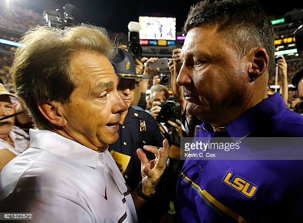 Head coach Nick Saban of the Alabama Crimson Tide shakes hands with head coach Ed Orgeron of the LSU Tigers after their 100 win at Tiger Stadium on...