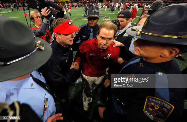 Head coach Nick Saban of the Alabama Crimson Tide shakes hands with head coach Kirby Smart of the Georgia Bulldogs after winning the CFP National...