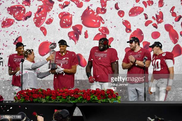 Head coach Nick Saban of the Alabama Crimson Tide shows the Leishman Trophy to his players on the presentation stage after the College Football...
