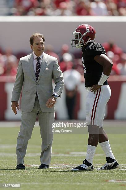 Head coach Nick Saban of the Alabama Crimson Tide speaks with Blake Sims of the Crimson team during the University of Alabama ADay spring game at...