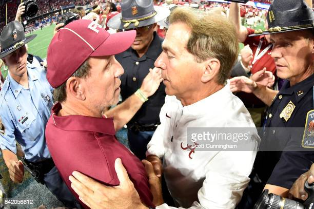Head coach Nick Saban of the Alabama Crimson Tide speaks with head coach Jimbo Fisher of the Florida State Seminoles after their game at MercedesBenz...