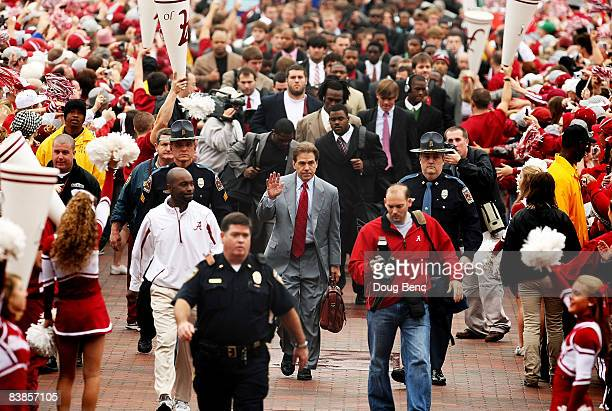 Head coach Nick Saban of the Alabama Crimson Tide waves to fans during the walk of champions before taking on the Auburn Tigers at BryantDenny...