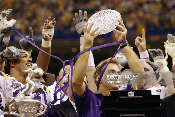 Head coach Nick Saban of the Loiusiana State Tigers holds up the Bowl Championship Series Trophy after his team defeated the Oklahoma Sooners in the...