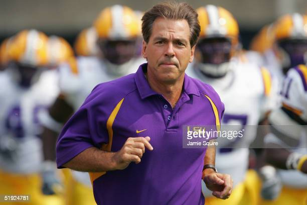 Head coach Nick Saban of the Louisiana State University Tigers takes the field against the Georgia Bulldogs during the game at Sanford Stadium on...