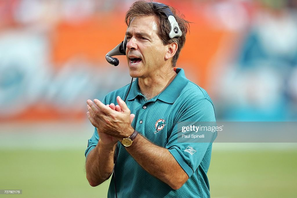 Head coach Nick Saban of the Miami Dolphins claps for his defense after a key series of downs against the New England Patriots at Dolphin Stadium on December 10, 2006 in Miami, Florida. The Dolphins defeated the Patriots 21-0.