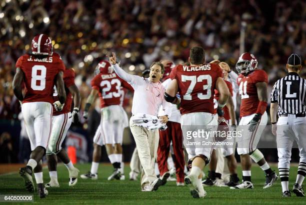 Head Coach Nick Saban of the University of Alabama celebrates with his team during the closing minutes of their victory over the University of Texas...