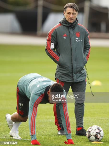 Head coach Nico Kovac keeps an eye on Corentin Tolisso of Bayern Muenchen during Bayern Muenchen training at Saebener Strasse training ground on...
