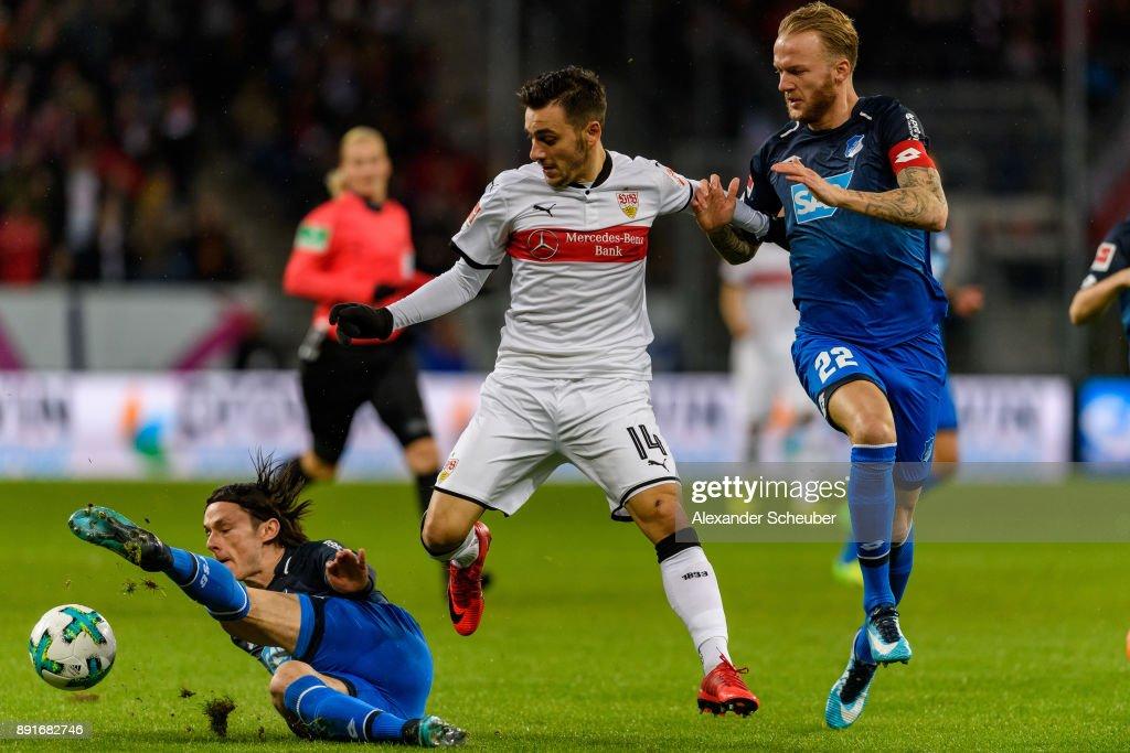 Head coach Nico Schulz of Hoffenheim and Kevin Vogt of Hoffenheim in action against Anastasios Donis of Stuttgart during the Bundesliga match between TSG 1899 Hoffenheim and VfB Stuttgart at Wirsol Rhein-Neckar-Arena on December 13, 2017 in Sinsheim, Germany.