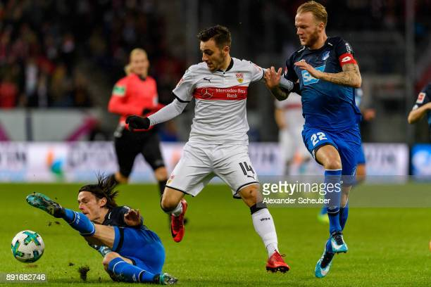 Head coach Nico Schulz of Hoffenheim and Kevin Vogt of Hoffenheim in action against Anastasios Donis of Stuttgart during the Bundesliga match between...