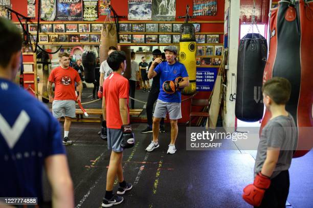 Head coach Nigel Travis leads a training session at the Moss Side Fire Station Boxing Club in Manchester, northwest England, on July 25, 2020 as...