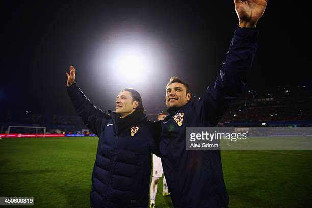 Head coach Niko Kovac and assistant coach Robert Kovac of Croatia celebrate after the FIFA 2014 World Cup Qualifier playoff second leg match between...