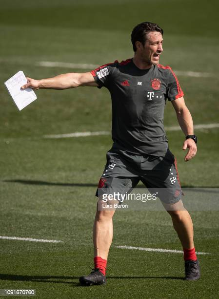 Head coach Niko Kovac gives instructions during a training session at day six of the Bayern Muenchen training camp at Aspire Academy on January 07...