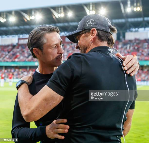 Head coach Niko Kovac of FC Bayern Muenchen and Head coach Claus-Dieter Wollitz of Energie Cottbus greet each other prior to the DFB Cup first round...