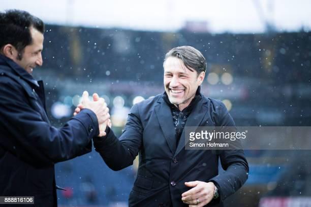 Head coach Niko Kovac of Frankfurt shakes hands with Hasan Salihamidzic sporting director of Bayern Muenchen during the Bundesliga match between...
