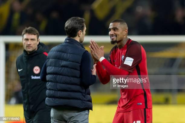 Head coach Niko Kovac of Frankfurt speaks with KevinPrince Boateng of Frankfurt after the Bundesliga match between Borussia Dortmund and Eintracht...