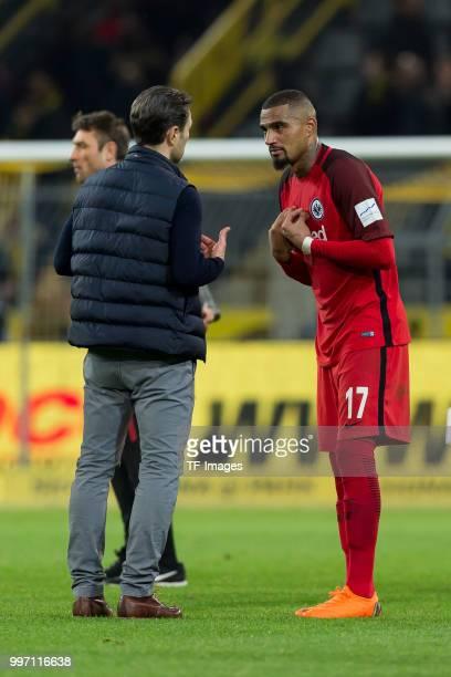 Head coach Niko Kovac of Frankfurt speaks with KevinPrince Boateng of Frankfurt during the Bundesliga match between Borussia Dortmund and Eintracht...