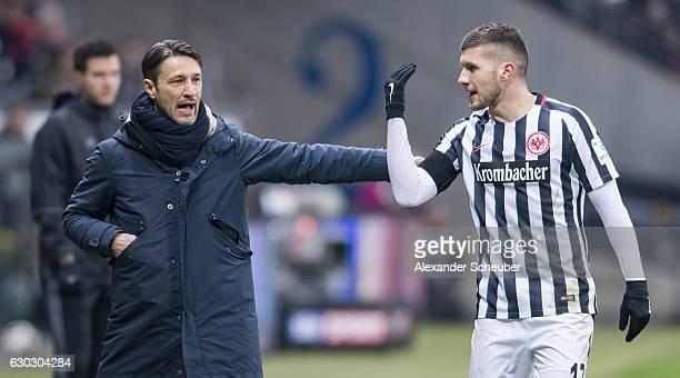 Head coach Niko Kovac of Frankfurt talks to Ante Rebic of Frankfurt during the Bundesliga match between Eintracht Frankfurt and 1 FSV Mainz 05 at...