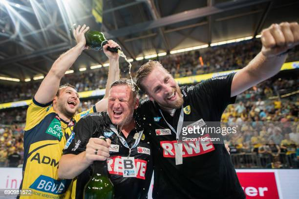 Head coach Nikolaj Jacobsen and Manager Oliver Roggisch of RheinNeckar Loewen are showered in champagne after the DKB HBL match between RheinNeckar...