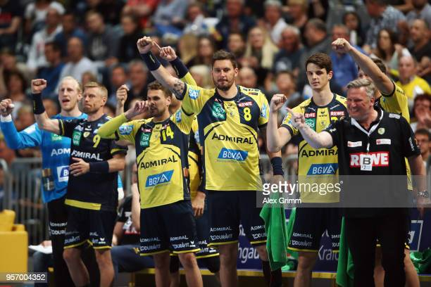 Head coach Nikolaj Jacobsen and players of RheinNeckar Loewen celebrate a goal during the DKB HBL match between RheinNeckar Loewen and SC Magdeburg...