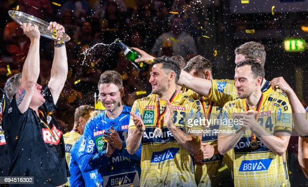 Head coach Nikolaj Jacobsen of Rhein Neckar Loewen Alexander Petersson of Rhein Neckar Loewen and Patrick Groetzki of Rhein Neckar Loewen celebrate...