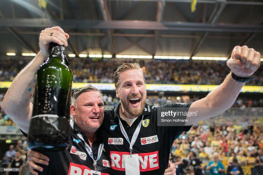 Head coach Nikolaj Jacobsen of Rhein-Neckar Loewen and Manager Oliver Roggisch (R) celebrate after the DKB HBL match between Rhein-Neckar Loewen and THW Kiel at SAP Arena on May 31, 2017 in Mannheim, Germany.