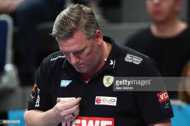 Head coach Nikolaj Jacobsen of RheinNeckar Loewen searches his chewing gum during the EHF Champions League Quarter Final Leg 2 match between Rhein...