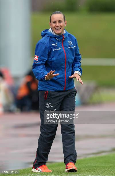 Head coach Nora Haeuptle of Switzerland gestures during the U19 women's elite round match between Germany and Switzerland at Friedensstadion on June...