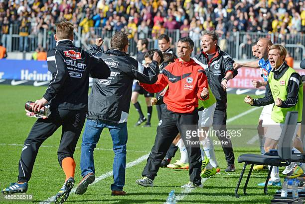 Head coach Norbert Meier and assistant coach Gino Lettieri of Bielefeld celebrate after winning the Second Bundesliga match between Dynamo Dresden...