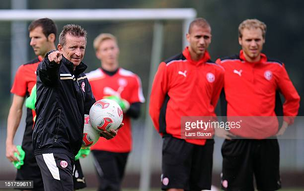 Head coach Norbert Meier gestures during a Fortuna Duesseldorf training session on September 11 2012 in Duesseldorf Germany