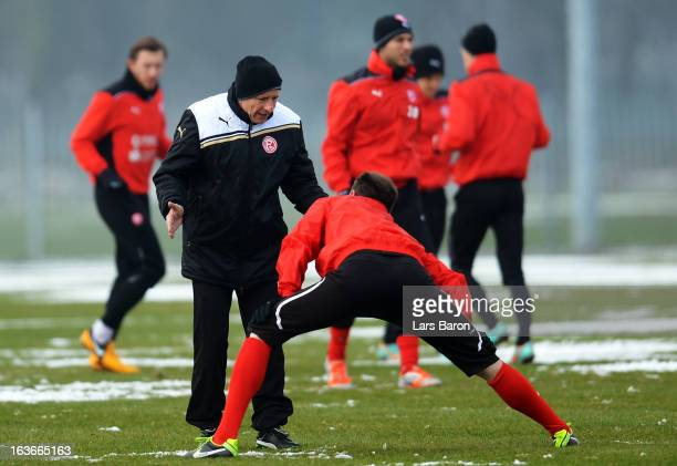 Head coach Norbert Meier gives instrucitons to his players during a Fortuna Duesseldorf training session on March 14 2013 in Duesseldorf Germany