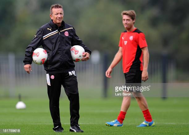 Head coach Norbert Meier looks on next to Andreas Lambertz during a Fortuna Duesseldorf training session on September 11 2012 in Duesseldorf Germany