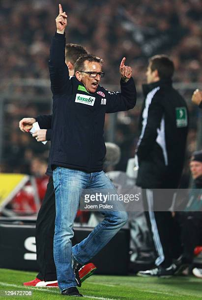 Head coach Norbert Meier of Duesseldorf celebrates after Maximilian Beister of Duesseldorf scored his team's third goal during the Second Bundesliga...