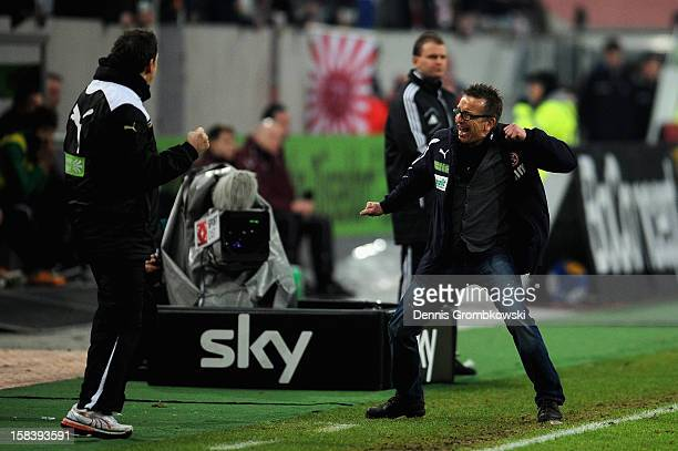 Head coach Norbert Meier of Duesseldorf celebrates after the final whistle of the Bundesliga match between Fortuna Duesseldorf 1895 and Hannover 96...