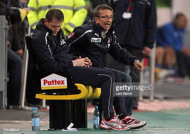 Head coach Norbert Meier of Duesseldorf looks dejected next to assistant coach Uwe Klein during the Second Bundesliga match between Fortuna...
